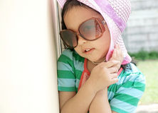 Cute little girl wearing sun glasses stock photos