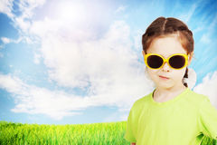 Cute little girl wearing sunglasses against nature backgr Royalty Free Stock Image