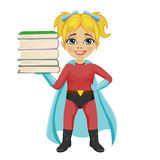 Cute little girl wearing superhero costume holding stack of books Royalty Free Stock Images