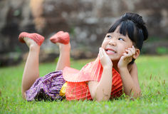 Cute little girl wearing typical thai dress royalty free stock image