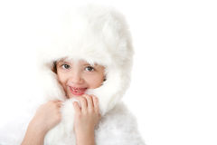 Cute little girl wearing a white fur coat and hat Royalty Free Stock Photos