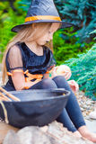 Cute little girl wearing witch costume with broom Royalty Free Stock Photography