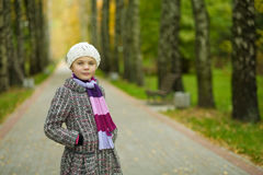 Cute little girl in white beret in park Stock Photography