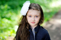 Cute little girl with white bow in her hair Royalty Free Stock Photography
