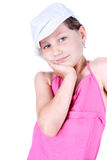 Cute little girl with white cap  posing Royalty Free Stock Photography