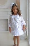 Cute little girl. In white dress Stock Image
