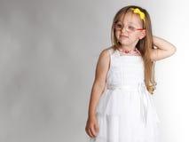 Cute little girl in white dress glasses Stock Photo