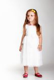 Cute little girl in white dress glasses Stock Image