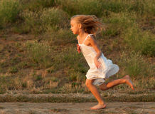 Little girl running outdoor Stock Photos