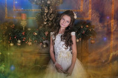 Cute little girl in a white princess dress Stock Photography