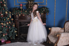 Cute little girl in a white princess dress Stock Images
