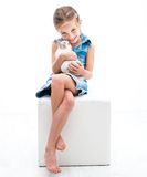 Cute little girl a white rabbit Royalty Free Stock Image