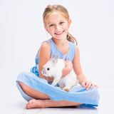 Cute little girl a white rabbit Stock Photo