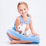 Cute little girl a white rabbit Stock Photo