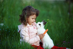 Cute little girl with white rabbit Stock Photography