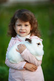 Cute little girl with white rabbit Royalty Free Stock Photo
