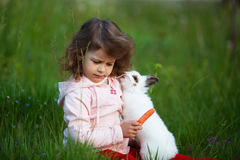 Cute little girl with white rabbit Royalty Free Stock Images