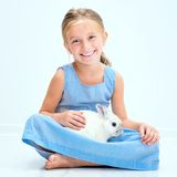 Cute little girl a white rabbit Royalty Free Stock Images