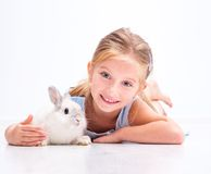 Cute little girl a white rabbit Royalty Free Stock Photos