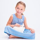 Cute little girl a white rabbit Royalty Free Stock Photography