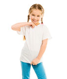 Cute little girl in a white T-shirt and blue jeans Royalty Free Stock Photo
