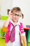 Cute little girl win eyeglasses and necktie Stock Photo