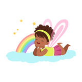 Cute little girl with wings lying on her stomach on a cloud next to the rainbow and dreaming, kids imagination and vector illustration