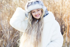 Cute little girl in winter clothes outdoors Stock Image