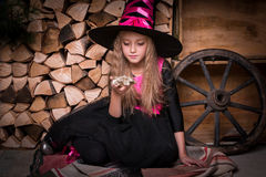 Cute little girl witch Royalty Free Stock Image