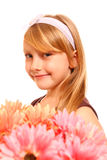 Cute Little Girl With Flowers - Gerberas On A White Background Royalty Free Stock Photography