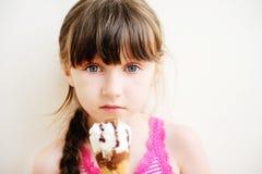Cute Little Girl With Ice Cream In Studio