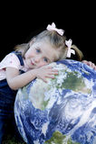 Cute Little Girl With The Earth Royalty Free Stock Images