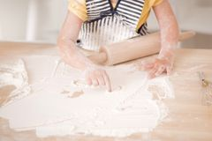 Cute little girl working with rolling pin Royalty Free Stock Image