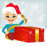 Cute little girl wrapping present Royalty Free Stock Photos