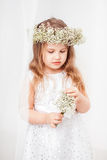 Cute little girl with a wreath. Cute little girl in white with a wreath Stock Photos