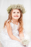 Cute little girl with a wreath. Cute little girl in white with a wreath Royalty Free Stock Images