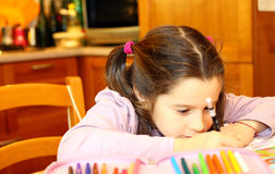 Cute little girl writes Royalty Free Stock Images