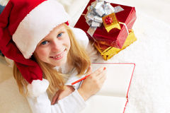 Cute little girl writes letter to Santa Claus Stock Images