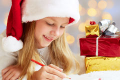 Cute little girl writes letter to Santa Claus Royalty Free Stock Images