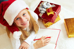 Cute little girl writes letter to Santa Claus Royalty Free Stock Photography