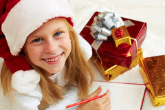 Cute little girl writes letter to Santa Claus Stock Photos
