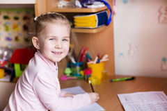 Cute little girl writing her homework Royalty Free Stock Image