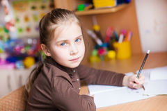 Cute little girl writing her homework Stock Image