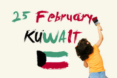 Cute little girl writing KUWAIT National Day25 February with Kuw Stock Photo