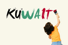 Cute little girl writing KUWAIT Stock Photo