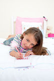 Cute Little girl writing on a notebook Royalty Free Stock Images