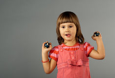 Cute little girl with In-Yan balls Stock Photography