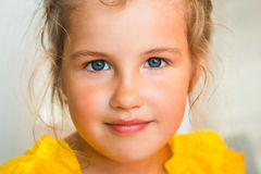 Cute little girl. In yellow Royalty Free Stock Images