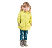 Cute little girl in yellow coat Royalty Free Stock Photography