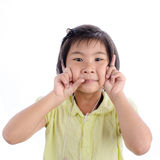 Cute little girl in yellow making funny face Stock Image